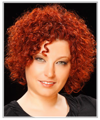Woman with short red curls