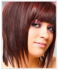 Woman with red hair and bangs