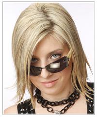 Model with blonde razor cut bob and glasses