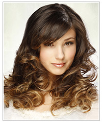 Model with long curly two-tone hair