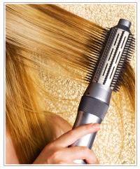 Model running brush through hair