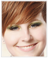 Model with red hair and green eye shadow
