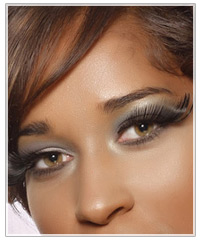 Model with brown hair and grey eye shadow