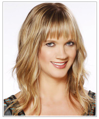 Model with blonde hair and full bangs