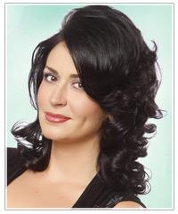 Model with dark, volume filled hair