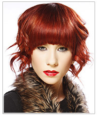Model with red hair and blunt bangs
