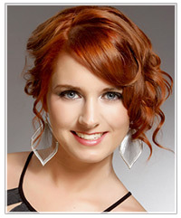 Model with wavy bangs and an upstyle