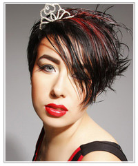 Model with short black hair and red highlights