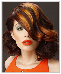 Model with red hair and orange highlights