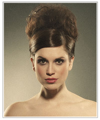 Model with a deep side part and an updo