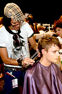Model getting haircut