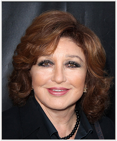 Angelica Maria Side Swept Bangs Hairstyle