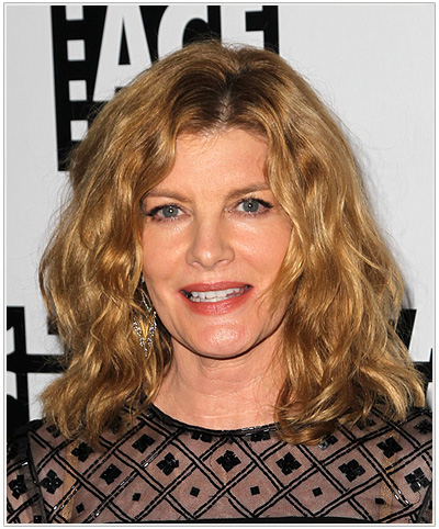 Rene Russo Medium Wavy Hairstyle.