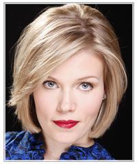 Woman with medium length solid cut blonde hair