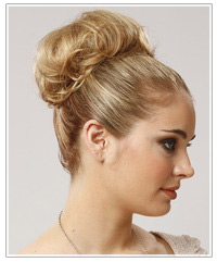 Model with blonde top knot updo