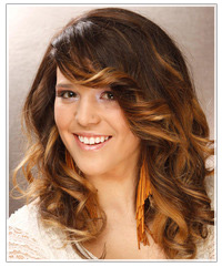 Model with long wavy highlighted hair