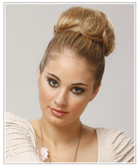 Model with a top knot bun