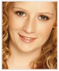 Model with long curly copper hair