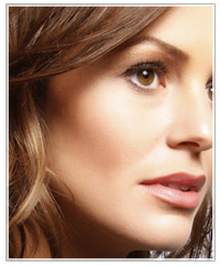 Model with brown hair and brown eye shadow