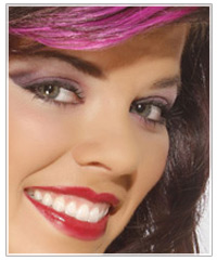 Model with brown hair and purple eye shadow