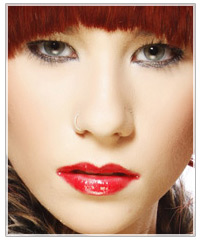 Model with red hair and red lips