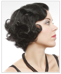 Model with short black curly hair