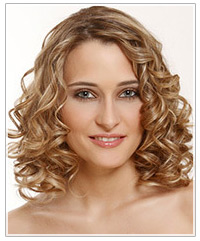Model with medium length blonde highlighted curly hair