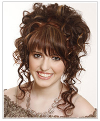 Model with brown highlighted curly hair