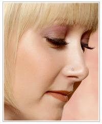 Model with purple eye shadow
