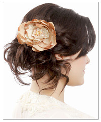 Model with flower hair accessory