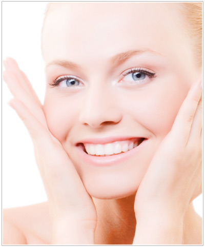 Model applying foundation to skin