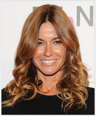 Kelly Bensimon Long Wavy Red Hairstyle